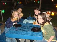 Sara, Alicia, Carmen, and Camille munching on some pizza