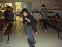 Josh skating in the fellowship hall