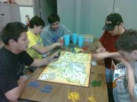 Guys playing RISK at 3am.
