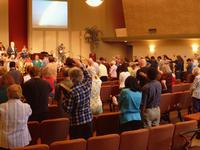 The congregation praying for our missionary Glen Chapman