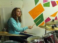 Donya playing drums for the worship team