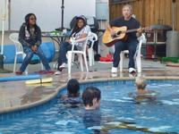 Les leading worship by the pool