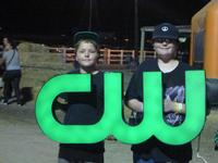 Donald and Brandan holding up the CW sign