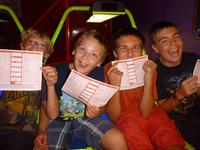 The boys showing their awesome kill sheets at Laser Quest