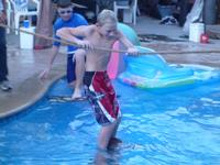 Ryan using a rope and Donald's shoulders to walk on water