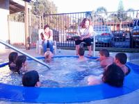 Pastor Jenny leading a lesson at the hot tub