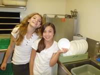 Ande and Rachel help clean dishes